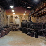 ancient cellar with barrels and ancient instruments