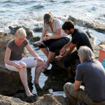cleaning fish on the rocks in a magical environment during a fish soup cooking lesson