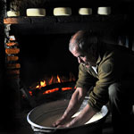 a shepherd making cheese