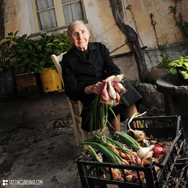 centenarian in his courtyard